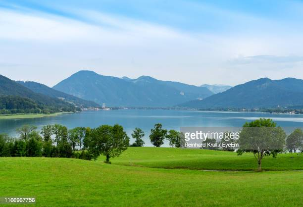 scenic view of lake and mountains against sky - tegernsee stock pictures, royalty-free photos & images
