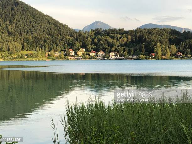 scenic view of lake and mountains against sky - boris stock photos and pictures