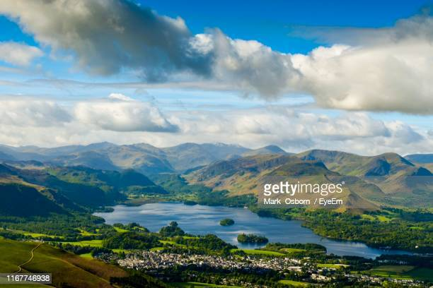 scenic view of lake and mountains against sky - keswick stock pictures, royalty-free photos & images