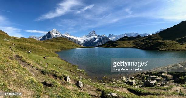 "scenic view of lake and mountains against sky - ""jörg peters"" stock-fotos und bilder"