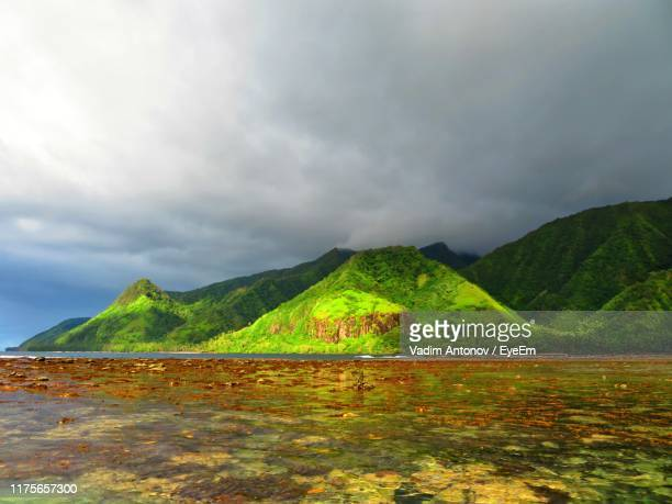 scenic view of lake and mountains against sky - antonov stock pictures, royalty-free photos & images