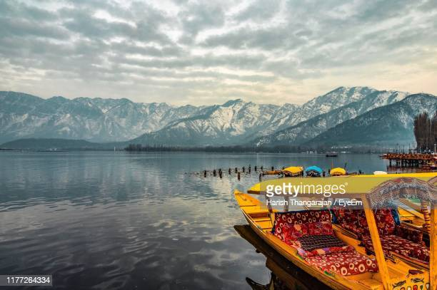 scenic view of lake and mountains against sky - srinagar stock pictures, royalty-free photos & images