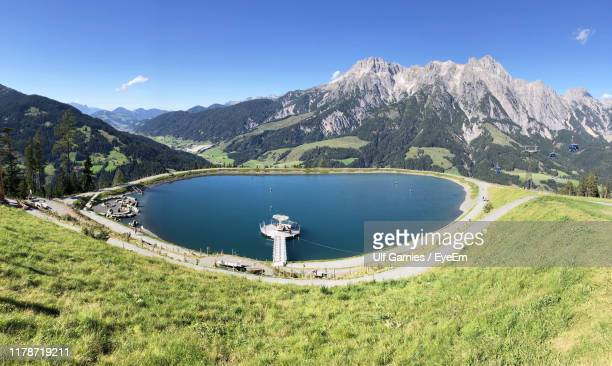 scenic view of lake and mountains against sky - leogang stock pictures, royalty-free photos & images