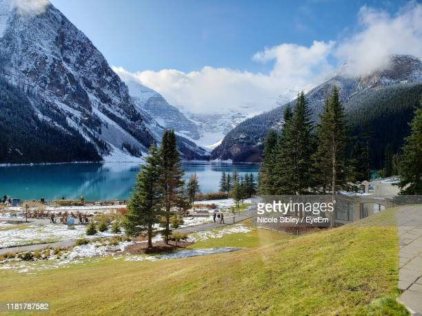scenic view of lake and mountains against sky - sibley stock photos and pictures