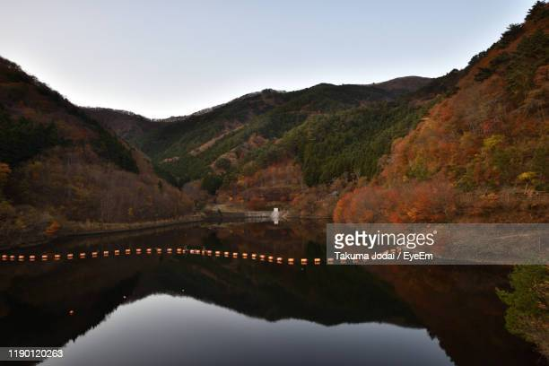scenic view of lake and mountains against sky - 東北地方 ストックフォトと画像