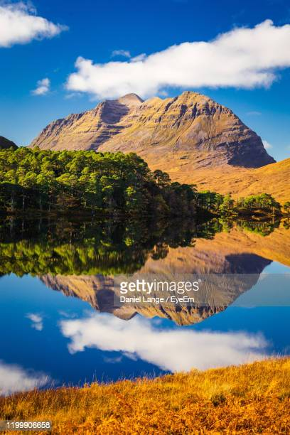 scenic view of lake and mountains against sky - lake stock pictures, royalty-free photos & images