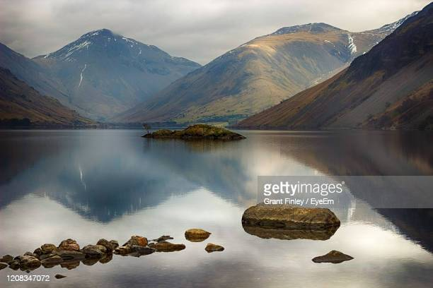 scenic view of lake and mountains against sky - cumbria stock pictures, royalty-free photos & images