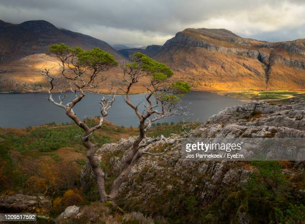 scenic view of lake and mountains against sky - wester ross stock pictures, royalty-free photos & images