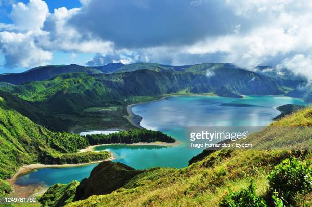 scenic view of lake and mountains against sky - azores fotografías e imágenes de stock