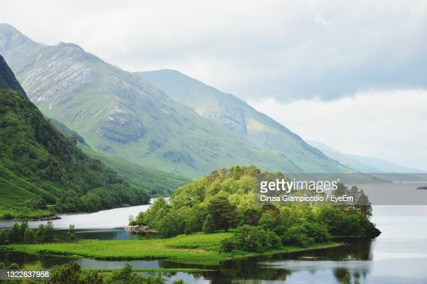 scenic view of lake and mountains against sky - drumnadrochit stock pictures, royalty-free photos & images