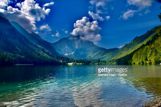scenic view of lake and mountains against sky - gerhard hagn stock-fotos und bilder