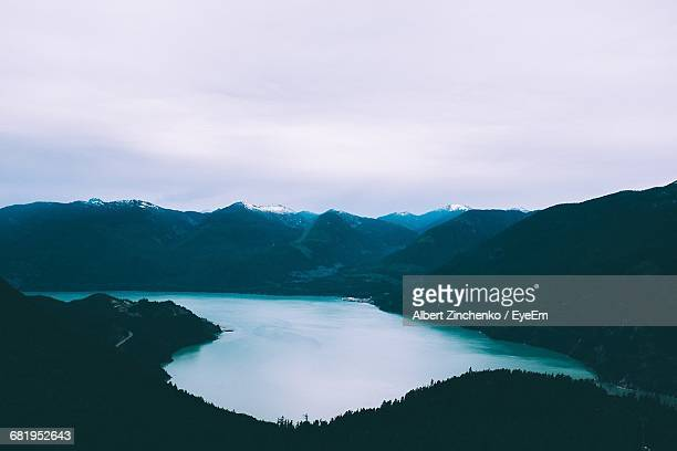 scenic view of lake and mountains against sky - zinchenko stock pictures, royalty-free photos & images