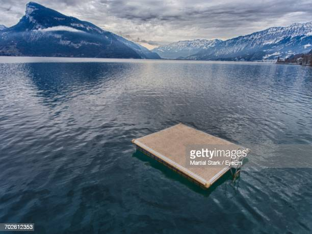 scenic view of lake and mountains against sky - diving platform stock pictures, royalty-free photos & images
