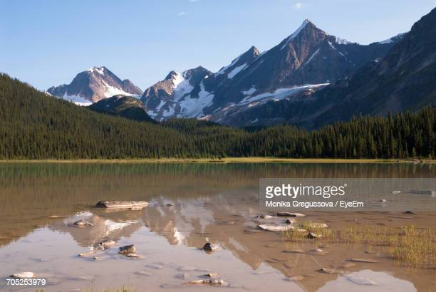scenic view of lake and mountains against sky - monika gregussova stock pictures, royalty-free photos & images