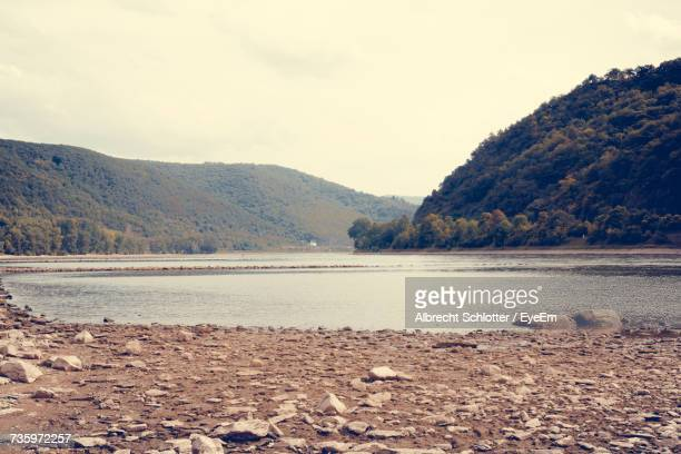 scenic view of lake and mountains against sky - albrecht schlotter stock photos and pictures