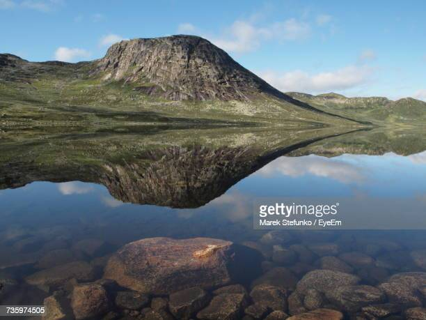 scenic view of lake and mountains against sky - telemark stock pictures, royalty-free photos & images