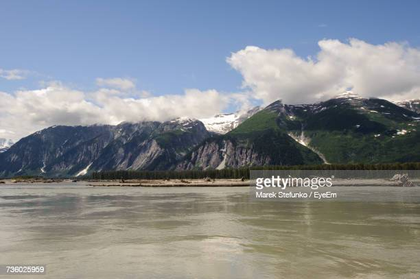 scenic view of lake and mountains against sky - marek stefunko stockfoto's en -beelden