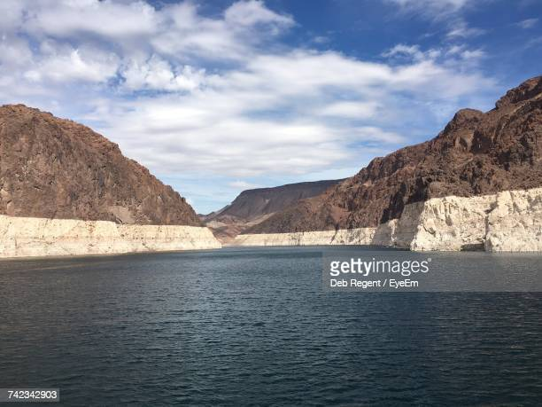scenic view of lake and mountains against sky - boulder city stock photos and pictures