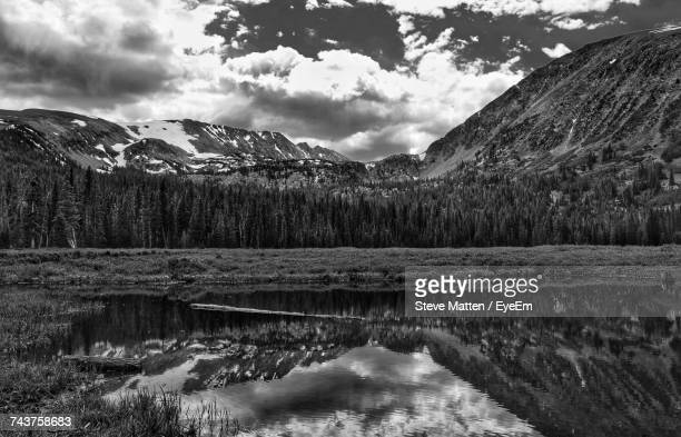 scenic view of lake and mountains against sky - steve matten stock pictures, royalty-free photos & images