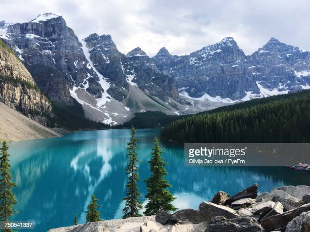 scenic view of lake and mountains against sky - banff stock photos and pictures