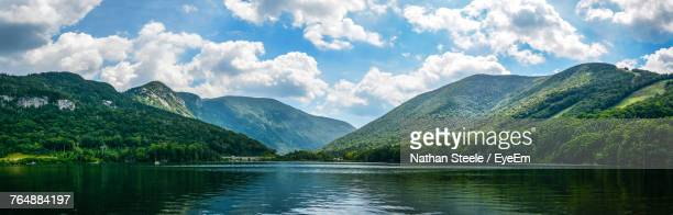 scenic view of lake and mountains against sky - new hampshire stock pictures, royalty-free photos & images