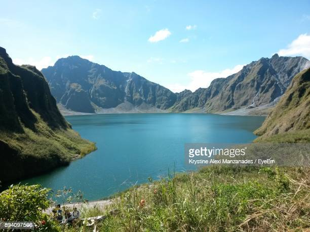 scenic view of lake and mountains against sky - mt pinatubo stock photos and pictures