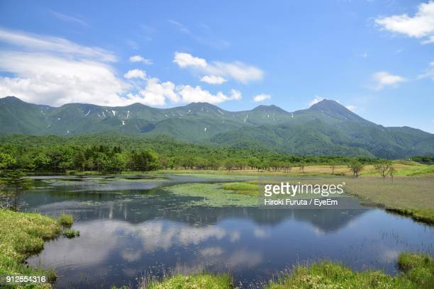scenic view of lake and mountains against sky - tottori prefecture stock photos and pictures