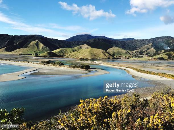 scenic view of lake and mountains against sky - nelson city new zealand stock pictures, royalty-free photos & images