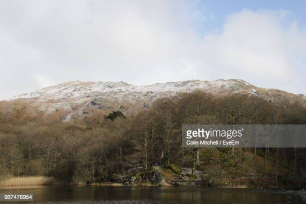 scenic view of lake and mountains against sky - ambleside stock photos and pictures