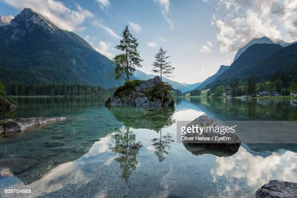 scenic view of lake and mountains against sky - berchtesgadener land stock photos and pictures
