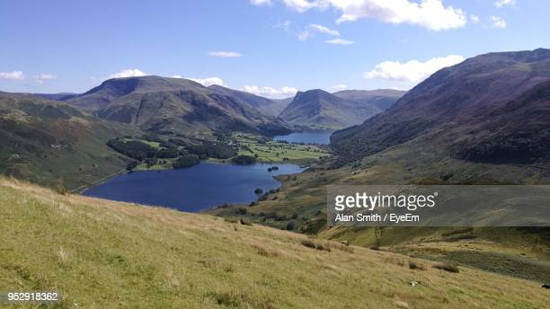scenic view of lake and mountains against sky - cumbria stock photos and pictures