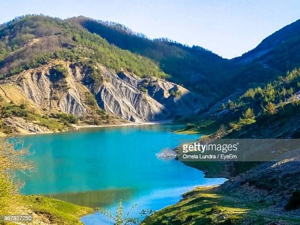 scenic view of lake and mountains against sky - albania stock pictures, royalty-free photos & images