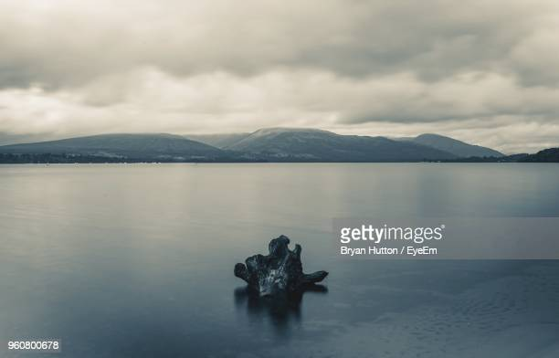 scenic view of lake and mountains against sky - hutton stock photos and pictures