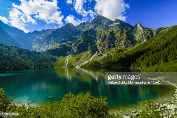 scenic view of lake and mountains against sky - zakopane stock pictures, royalty-free photos & images