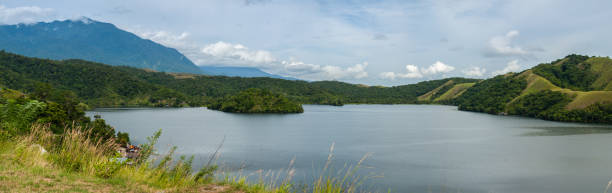 Scenic View Of Lake And Mountains Against Sky, Sawoi, Indonesia