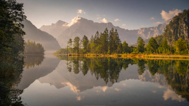 Scenic view of lake and mountains against sky,Almsee,Austria