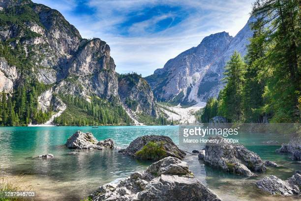 scenic view of lake and mountains against sky,lago di braies,braies,south tyrol,italy - nature stock pictures, royalty-free photos & images