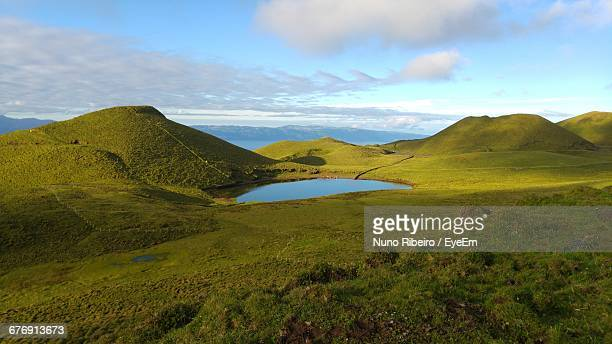 Scenic View Of Lake And Mountains At Pico Island Against Sky