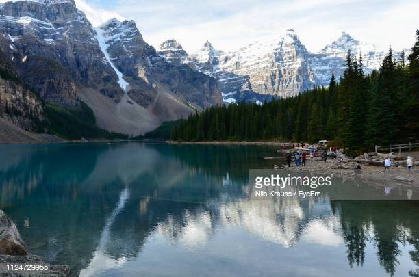 scenic view of lake and mountains during winter - lake louise lake stock pictures, royalty-free photos & images