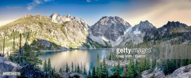 scenic view of lake and mountains during winter - leavenworth washington stock photos and pictures