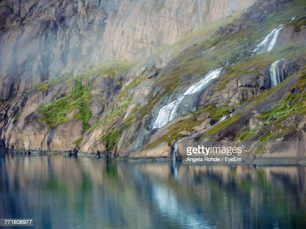 scenic view of lake and mountains - angela rohde stock-fotos und bilder