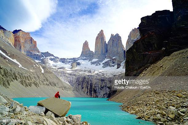 Scenic View Of Lake And Rock Formation At Torres Del Paine National Park