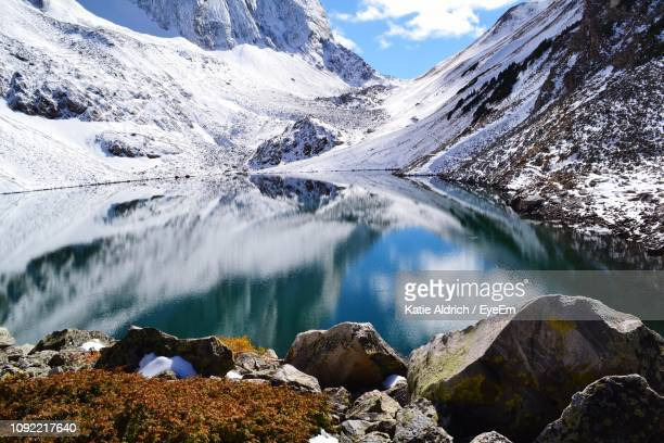 scenic view of lake and snowcapped mountains against sky - basalt stock pictures, royalty-free photos & images