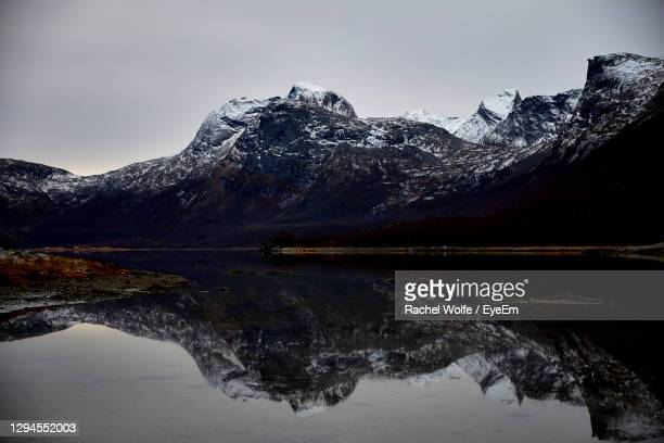 scenic view of lake and snowcapped mountains against sky - rachel wolfe stock pictures, royalty-free photos & images