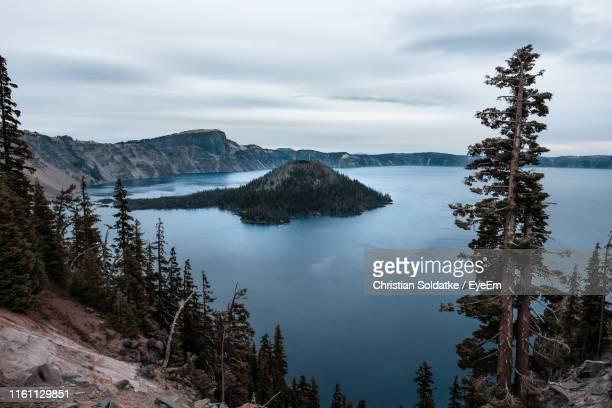 scenic view of lake and trees against sky - christian soldatke stock pictures, royalty-free photos & images