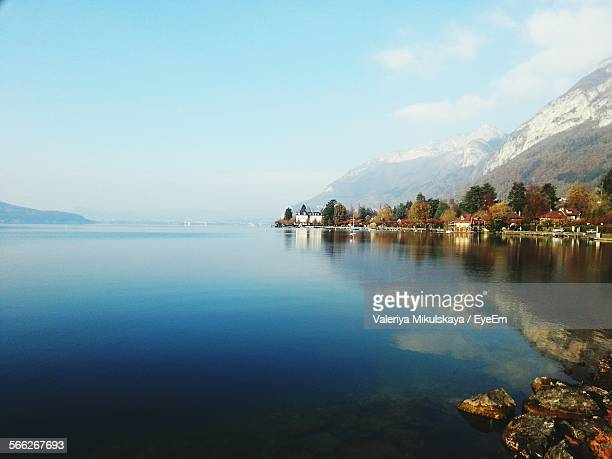 scenic view of lake annecy against sky - lake annecy stock photos and pictures