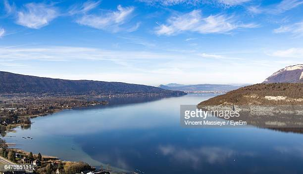 scenic view of lake annecy and mountains against sky - lake annecy stock photos and pictures