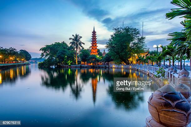 Scenic View Of Lake At Tran Quoc Pagoda Against Sky