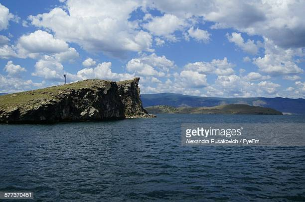 Scenic View Of Lake Baikal And Rock Formation Against Cloudy Sky