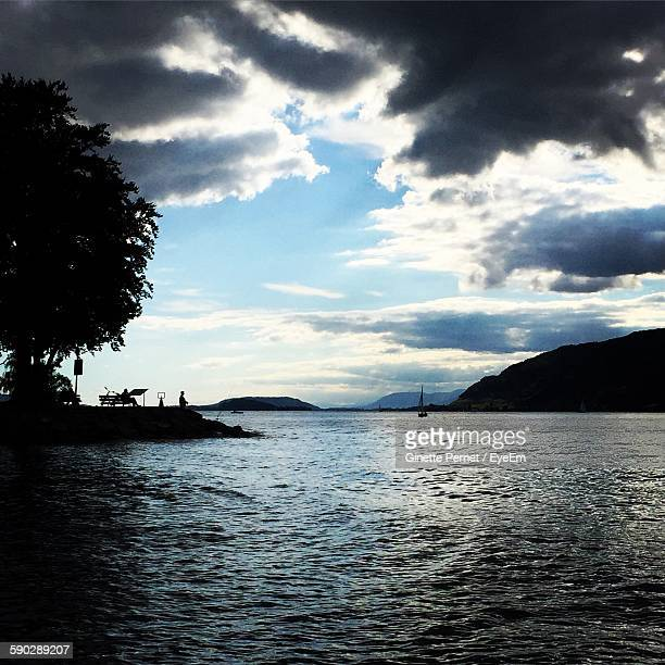 Scenic View Of Lake Biel Against Cloudy Sky